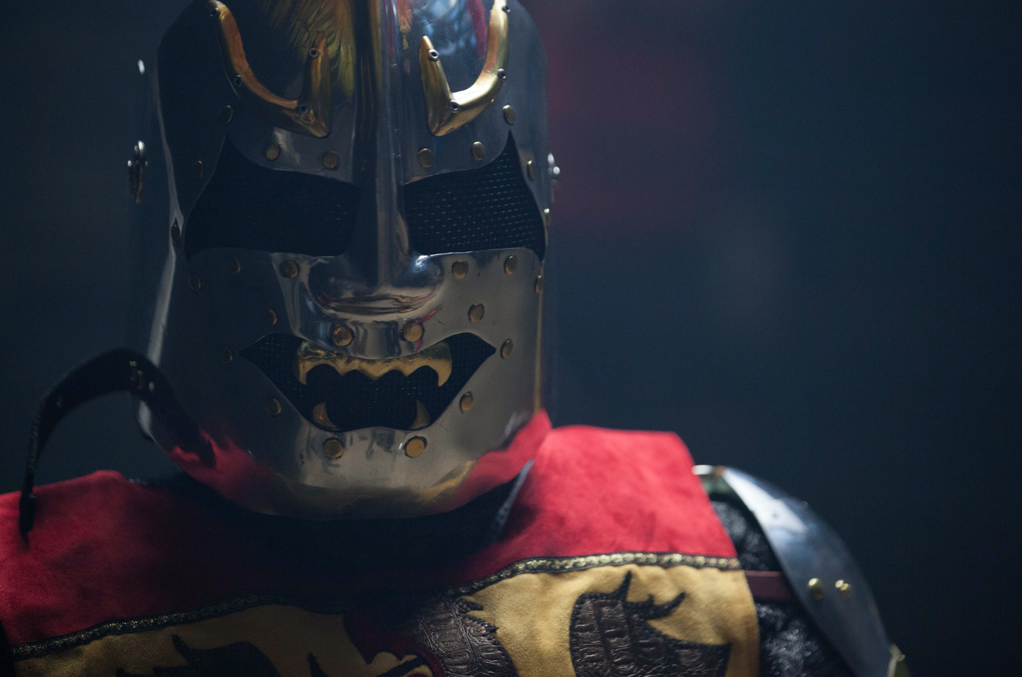 A closeup of a Knight in full armor.